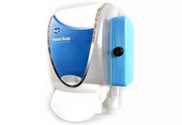 The Clean Hands – Safe Hands device is a wall-mounted soap and alcohol dispenser with a sensor mounted on the side.